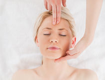 Attractive blond-haired woman getting a massage Royalty Free Stock Photos