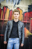 Attractive blond haired young man standing Royalty Free Stock Images