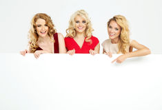 Attractive blond ladies holding board Royalty Free Stock Photos