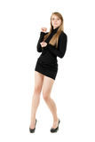 Attractive blond lady. Posing in black short dress. Isolated on white stock photography