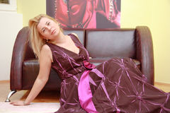 An attractive blond model. Posing in a designer dress stock photos