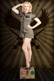 Attractive blond pin-up army girl. Military salute Stock Photos
