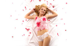Attractive blond with pink petals Stock Photography