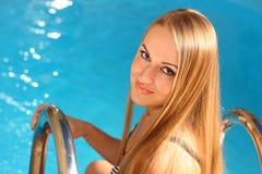 attractive blond pool woman young Стоковое Изображение RF