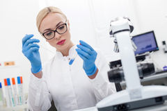 Attractive blond researcher is analyzing sample Stock Photos