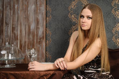 Attractive blond sad girl waiting in cafe Royalty Free Stock Image