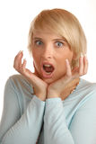 Attractive blond with scary face Royalty Free Stock Photos