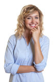 Attractive blond secretary laughing at camera Royalty Free Stock Images
