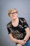 Attractive blond senior woman wearing glasses Stock Photography