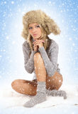 Attractive blond in sexy winter clothes Stock Photos