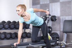 Attractive blond sporty girl doing triceps training Royalty Free Stock Images