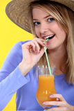 Attractive blond in straw hat Royalty Free Stock Photography