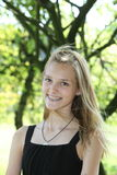 Attractive blond teenager with a lovely smile Stock Photography