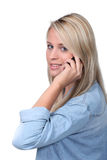 Attractive blond using mobile Royalty Free Stock Photography