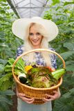 Attractive blond woman with a basket of vegetables Royalty Free Stock Photography