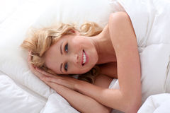 Attractive blond woman in bed Royalty Free Stock Image