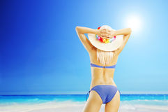 Attractive blond woman in bikini on a beach Royalty Free Stock Photography