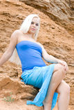 Attractive blond woman in blue Royalty Free Stock Photos