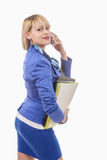 Attractive blond woman in blue business suit, phone Royalty Free Stock Photography