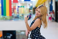 Attractive blond woman with credit cards Royalty Free Stock Images