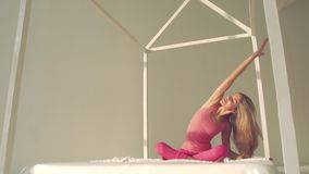 Attractive blond woman doing yoga on a sunny day stock footage