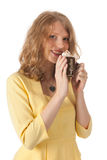 Attractive blond woman drinking coffee Royalty Free Stock Photography