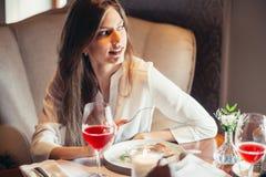 Attractive blond woman drinking wine in luxury interior. stock photos