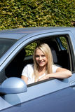 Attractive blond woman driver Royalty Free Stock Photography
