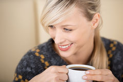 Attractive blond woman enjoying her cup of coffee Royalty Free Stock Photo