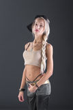Attractive blond woman on gray background Royalty Free Stock Photography