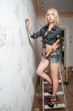 Attractive blond woman with hammer and screw Royalty Free Stock Photos
