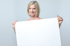 Attractive blond woman holding a blank sign Stock Image