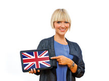 Attractive blond woman holding tablet with united kingdom flag Royalty Free Stock Photography
