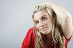 Attractive blond woman ina red top Royalty Free Stock Photos