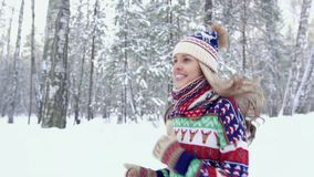 Attractive blond woman jogging in the forest on a winter day stock video