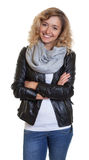 Attractive blond woman in a leather jacket Royalty Free Stock Images