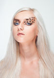 Attractive blond woman with leopard makeup Royalty Free Stock Photography
