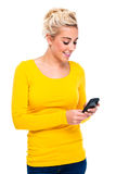 Attractive Blond Woman Looking at Cell Phone Royalty Free Stock Images