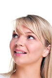 Attractive blond woman looking up Stock Image