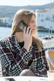 Blond woman on the phone calling Royalty Free Stock Photos