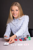 Attractive blond woman with playing cards and poker chips Royalty Free Stock Photo