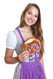 Attractive blond woman in a purple dress with pretzel Stock Images