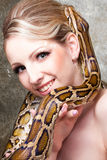 Attractive blond woman with python on grey Royalty Free Stock Photo