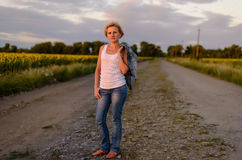 Attractive blond woman on a rural farm road Royalty Free Stock Photos