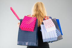 Attractive blond woman with shopping bags Stock Image