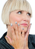 Attractive blond woman with silver fingernails Stock Image