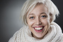 Attractive blond woman smiling charmingly Royalty Free Stock Image