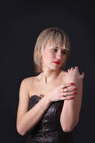 Attractive blond woman on studio dark background Royalty Free Stock Images