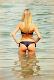 Attractive blond woman on the water Royalty Free Stock Photography