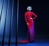 Attractive blond woman wearing evening gown Royalty Free Stock Photos